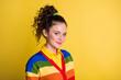 Leinwandbild Motiv Photo portrait of cute girl smiling isolated on bright yellow colored background