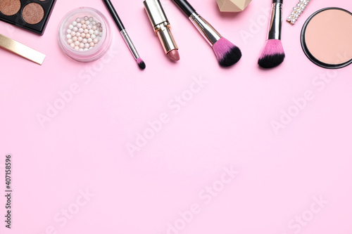Fotografie, Obraz Makeup brushes and cosmetic products on pink background, flat lay