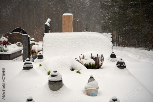 Fototapeta cemetery during winter,tombstone covered with snow   obraz