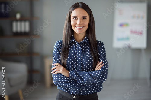 Canvas Print Photo of happy joyful confident young woman wear formalwear folded hands indoors