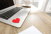 Red Heart On Laptop In Office. Valentine's Day Celebration