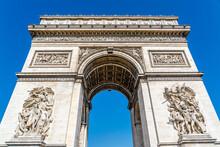 The Arc De Triomphe De L'Étoile,Triumphal Arch Of The Star, One Of The Most Famous Monuments In Paris, France, At The Western End Of The Champs-Élysées At The Centre Of Place Charles De Gaulle