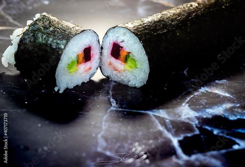 Fototapeta homemade sushi traditional japanese master making healthy maki rolls with prawns cucumber carrot fish obraz