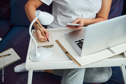 Obraz Businesswoman working online during isolation at home - fototapety do salonu
