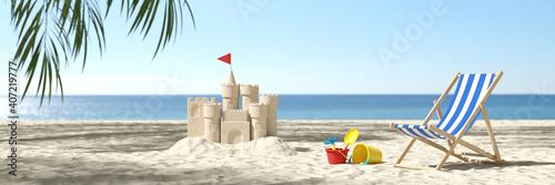 Obraz Sandspielzeug mit Sandburg am Strand im Karibik Urlaub - fototapety do salonu
