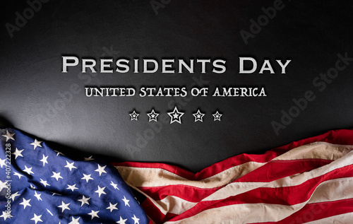 Fototapeta Happy presidents day concept with flag of the United States on black wooden background