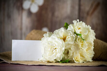 Bouquet Of Beautiful White Roses On Table