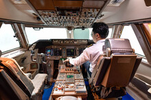 Airline Pilot Work In The Cockpit