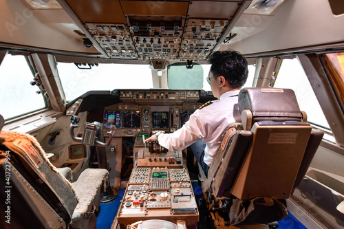 Fotografie, Tablou Airline pilot work in the cockpit