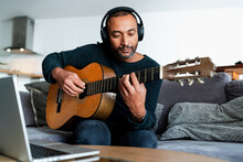 40 Years Old Man Learning The Guitar With Online Lessons At Home