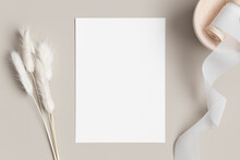 White Invitation Card Mockup With A Lagurus On A Beige Table. 5x7 Ratio, Similar To A6, A5.