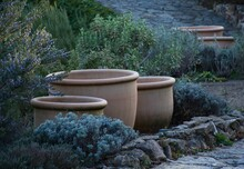 Mediterranean Garden In Early Spring. Three Empty Ceramic Flower Pots Ready For Planting.