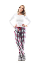 Beautiful Young Woman In Domestic Sleepwear Comfy Clothes Posing At Camera With Arms Akimbo. Full Length Portrait On White Background.