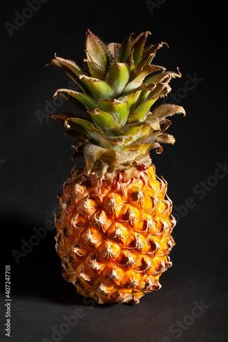 Fotografie, Obraz mini pineapple  on black background