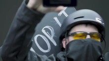 Male Activist Protestor Raise Up Fist And Shooting Video On Smartphone, Live Broadcast From Picket, Close Up