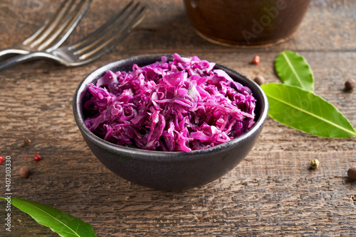 Fermented red cabbage in a bowl on a table Fototapeta