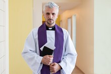 Catholic Priest Holding Envelope With Money During Pastoral Visit Called Kolenda In Poland, Church And Money