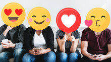 Diverse People With Positive Emoticons Using Mobile Phones