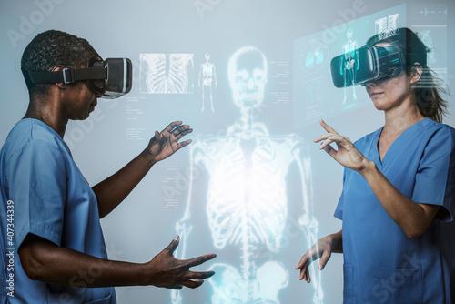 Obraz Doctors wearing VR simulation with hologram medical technology - fototapety do salonu