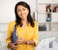 Cheerful Business Woman In Light Office Holding Clipboard With Papers Document Write Notes