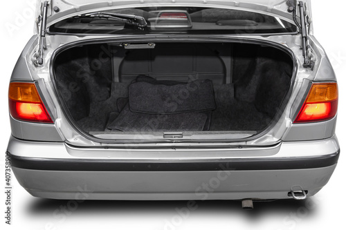 Fotografie, Obraz Clean, open empty trunk in the silver car sedan  on white isolated  background