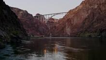 Aerial Caucasian Man Standing On Rocks River Between Cliffs Day