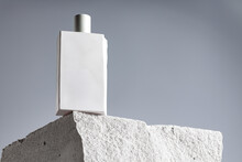 Bottle Of Perfume On Cinder Block Close Up
