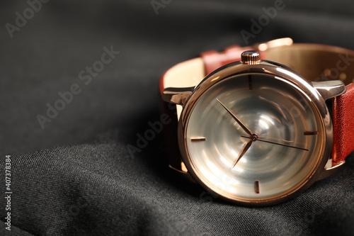 Fotografija Luxury wrist watch on black background, closeup. Space for text