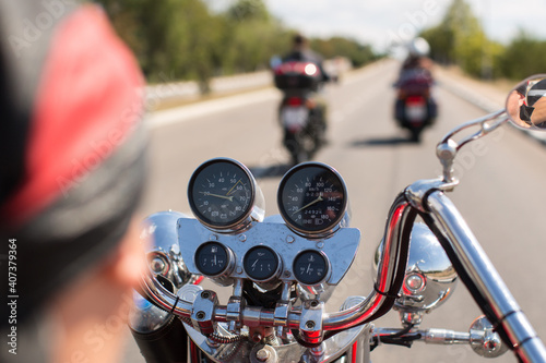 Obraz na plátne Biker riding motorcycle on road in morning sunny day