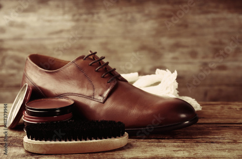 Stampa su Tela Footwear care accessories and shoe on wooden background