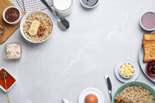 Flat Lay Composition With Tasty Breakfast Food On Light Grey Marble Table. Space For Text