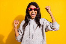 Photo Of Triumphant Afro American Woman Raise Fists Wear Sunglass Luck Win Isolated On Yellow Color Background