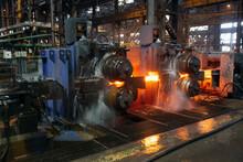 Hot Steel On Conveyor In A Steel Mill. Hot Rolled Rebar
