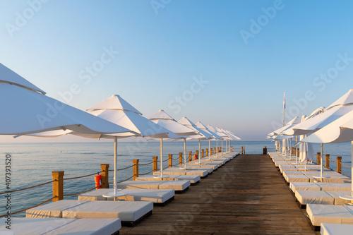 Tela Pier with sunbeds and umbrellas