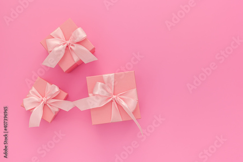 Valentines day composition: three pink gift boxes with ribbon