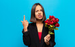 young pretty woman holding a bouquet of roses