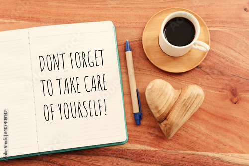 Fotografia self care concept. notebook with text over pink background