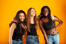 Diverse Multi Nation Girls Group, Teenage Friends Company Cheerful Having Fun, Happy Smiling, Cute Posing On Yellow Background, Lifestyle People Concept, African-american, Asian And Caucasian
