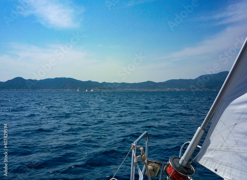 sail boat yacht in race regatta with mountain background Wallpaper Mural