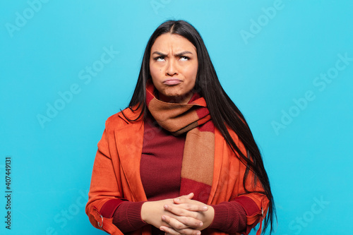 Fotografie, Obraz latin woman looking goofy and funny with a silly cross-eyed expression, joking a