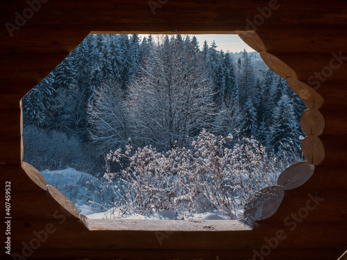 View from  wooden house with plunge font pool for ablutions at the holy spring in a natural park in sunny winter day Fototapet