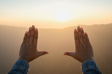 Woman Hand Framing Looking View Sunrise On Mountain