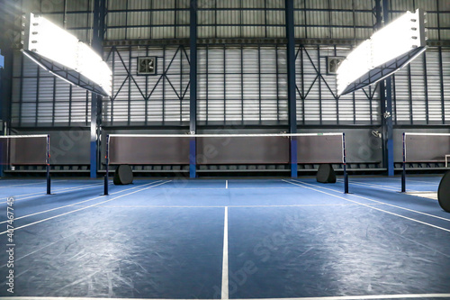 Old badminton back court side blue background Fototapeta
