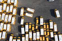 Aerial View Of Many Yellow School Buses Parked At A Depot