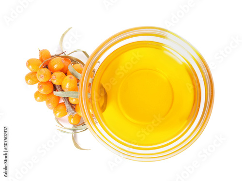 Obraz Natural sea buckthorn oil and fresh berries on white background, top view - fototapety do salonu