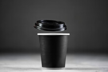 Paper Cup Of Coffee On Dark Background