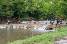 Turner Falls, Oklahoma, USA – July 3, 2015:People Are Swimming And Playing In The Water Of Honey Creek Near Turner Falls, Oklahoma.