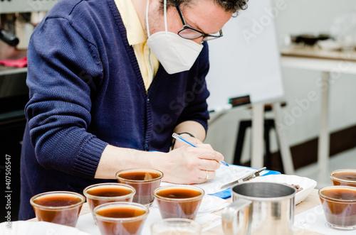 Fototapeta Professional coffee taster testing new smells and flavors. obraz