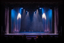 Theater Stage, Colored Puffs Of Smoke In Stage Light