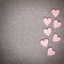 Heart Drawn On A Canvas. Valentine's Day. Pink Wooden Hearts On A Fabric Background.